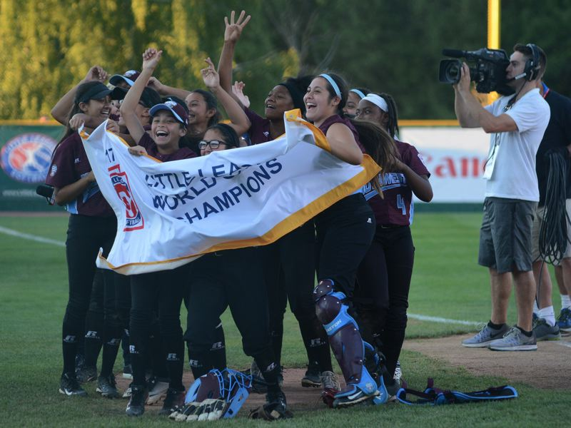 PAMPLIN MEDIA GROUP: DAVID BALL - Members of the Lake Air squad out of Waco, Texas wave the Little League Softball World Series banner for their fans after closing out a 7-2 win over Rowan, North Carolina.