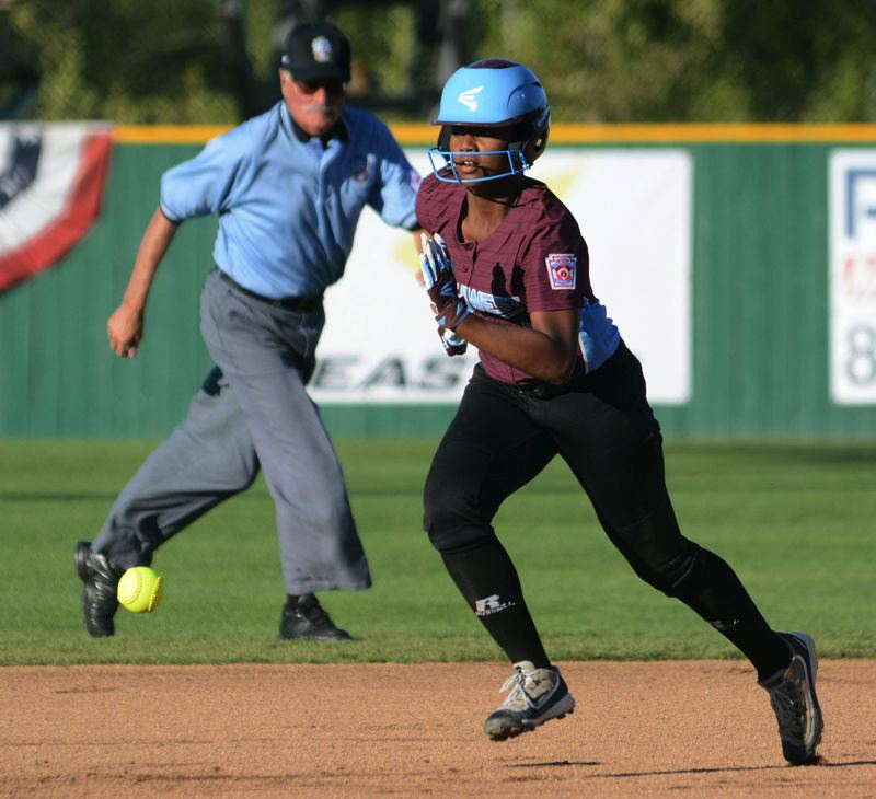 PAMPLIN MEDIA GROUP: DAVID BALL - Waco's Asharah Thibodeaux waits for a grounder to pass on her way to scoring the team's first run off a single by Serena Guardiola in the first inning.