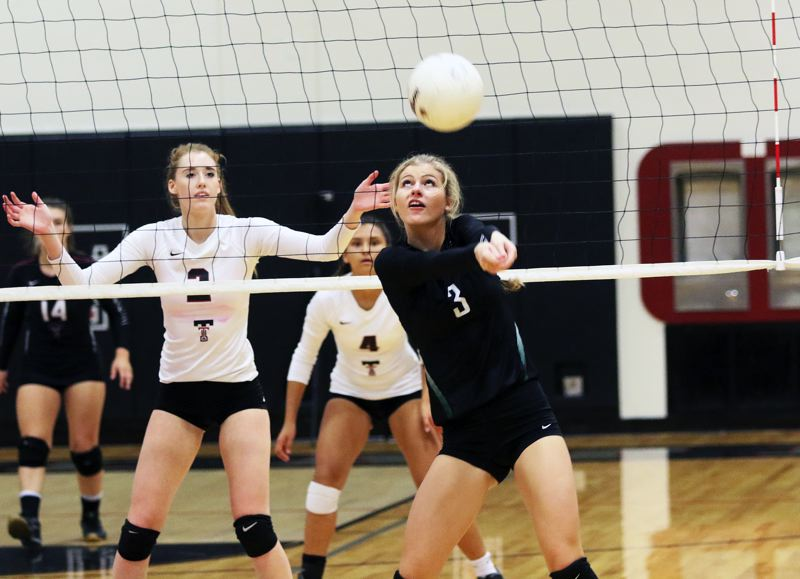 DAN BROOD - The Tigard and Tualatin high school volleyball teams, shown here in a 2016 match, will meet this year in Three Rivers League play Sept. 20 at Tualatin High School, and Oct. 17 at Tigard High School.