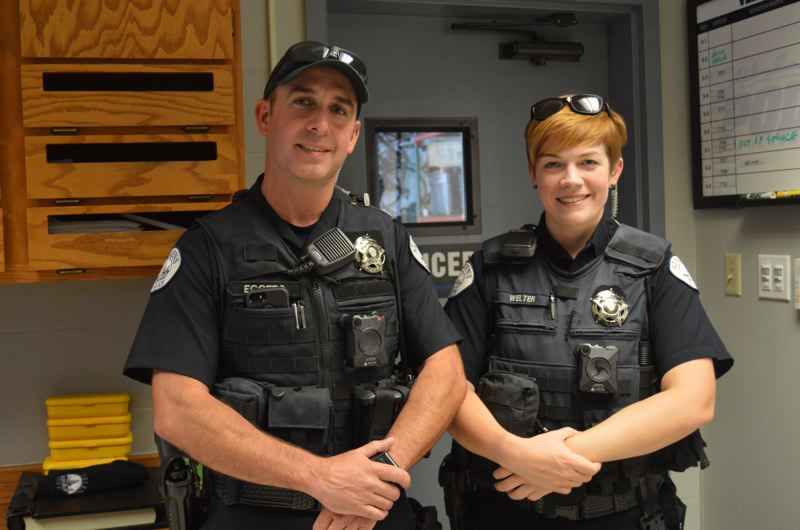SPOTLIGHT PHOTO: NICOLE THILL - St. Helens Police Department Officers Jon Eggers and Kate Welter wear body cameras attached to their safety vests. The black square cameras, attached with a magnetic holster, will be used by all uniformed officers with the St. Helens Police Department.