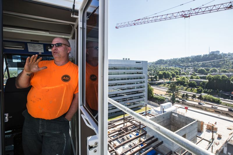 PAMPLIN MEDIA GROUP: JON HOUSE - Whitman climbs up the 180-foot towers ladders without being plagued by vertigo, and works 11 or 12 hours before coming down.