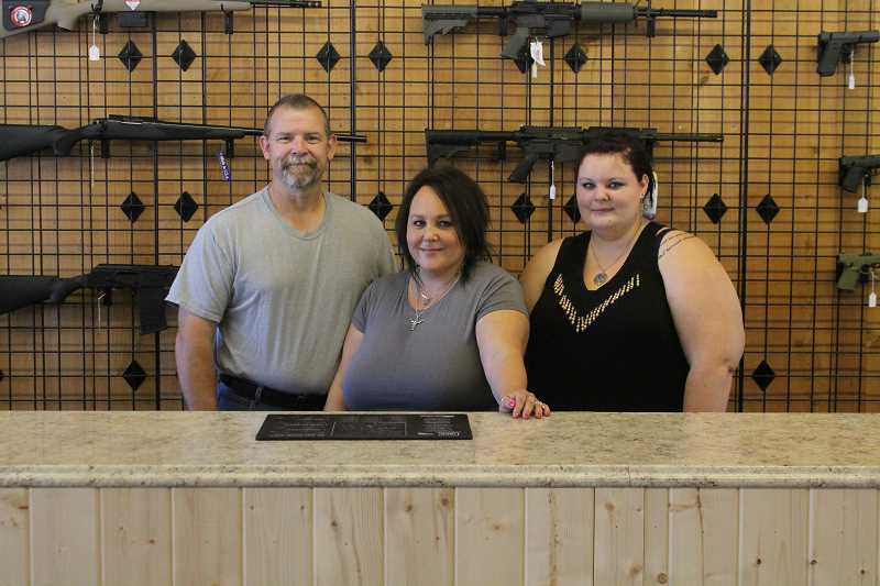 PIONEER PHOTO: CONNER WILLIAMS - Stampede Armory is a family-run business in downtown Molalla and is open to the public. From left: Jim Wimsatt, Lisa Wimsatt, Amber Wimsatt.