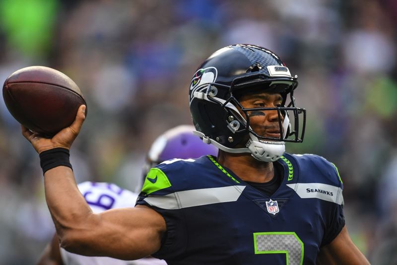 COURTESY: MICHAEL WORKMAN - Russell Wilson of the Seattle Seahawks unloads a pass Friday night against the Minnesota Vikings.