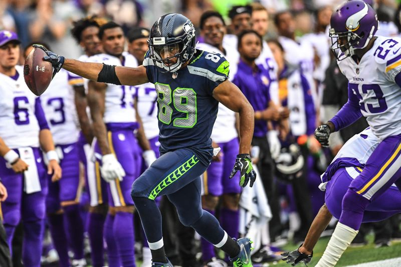 COURTESY: MICHAEL WORKMAN - Doug Baldwin of Seattle heads to the sidelines after one of his four receptions against the Vikings.