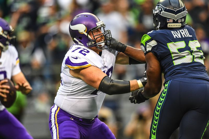 COURTESY: MICHAEL WORKMAN - Mike Remmers (left), veteran NFL lineman from Jesuit High and Oregon State, blocks Cliff Avril for Seattle as the Minnesota Vikings try to protect quarterback Sam Bradford.