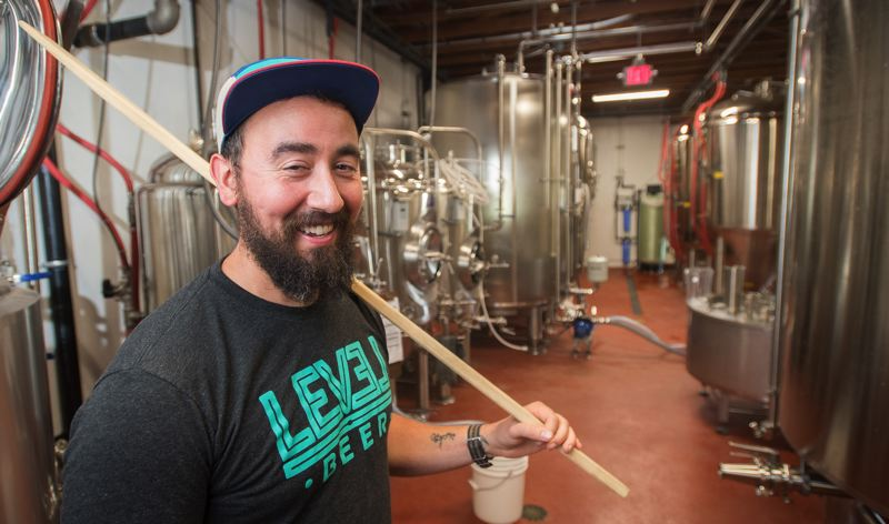 OUTLOOK PHOTO: JOSH KULLA - Level Beer co-owner Jason Barbee jokingly says that 90 percent of his time as a brewer is actually spent as a janitor. He and two partners opened their brewery and public house at the site of a former farmers market on Northeast 148th Avenue just off Marine Drive.