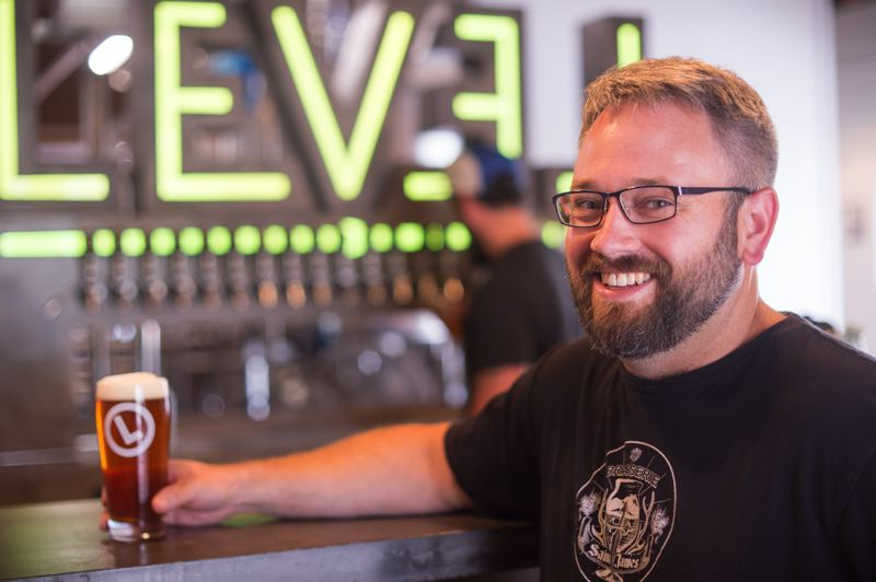 OUTLOOK PHOTO: JOSH KULLA - Level Beer brewer and co-founder Shane Watterson likens his job to a professional beer drinker. The 20-barrel brewhouse opened last month in Northeast Portland and already is raising a stir in the local beer industry.