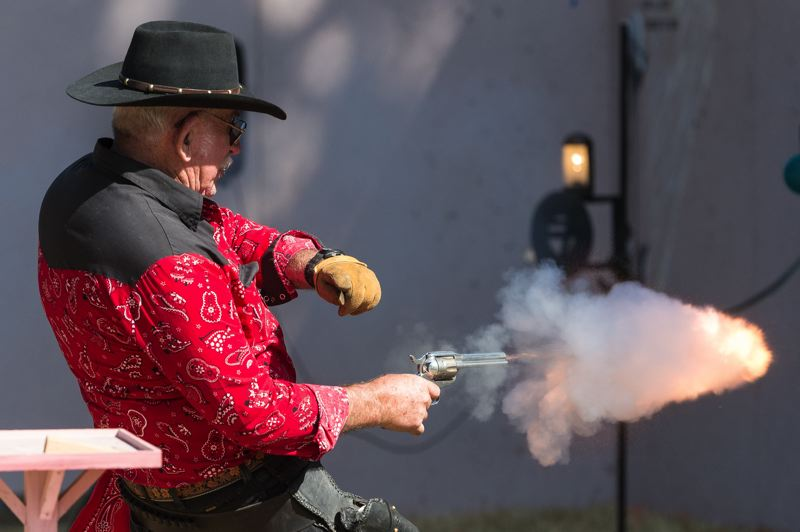 NEWS-TIMES PHOTO: CHRISTOPHER OERTELL - Howard Baker, from Forest Grove, fires his gun during the Oregon 6 Gun Fast Draw World Championships at the Banks BBQ in Banks.