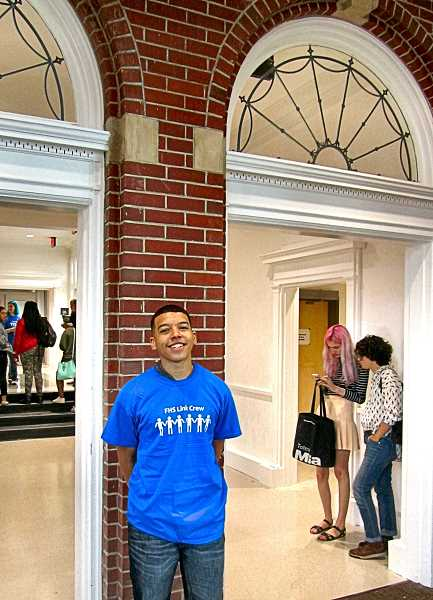 ERIC NORBERG - Jeremy London, a junior at Franklin High this fall, was unrestrained in his enthusiasm for the renovated and updated campus, and posed at an arch that represented one of the many historic touches retained, in the redesign of the century-old high school.