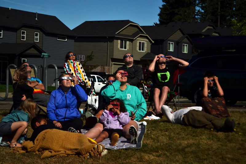 POST PHOTO: BRITTANY ALLEN - Community members gaze upward as solar eclipse reaches 99 percent totality.