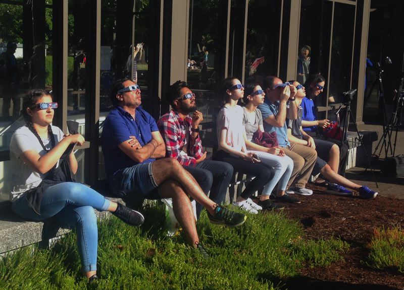 CLAIRE WITHYCOMBE/CAPITAL BUREAU - Observers of the total solar eclipse gathered on the Oregon Capitol Mall Monday.