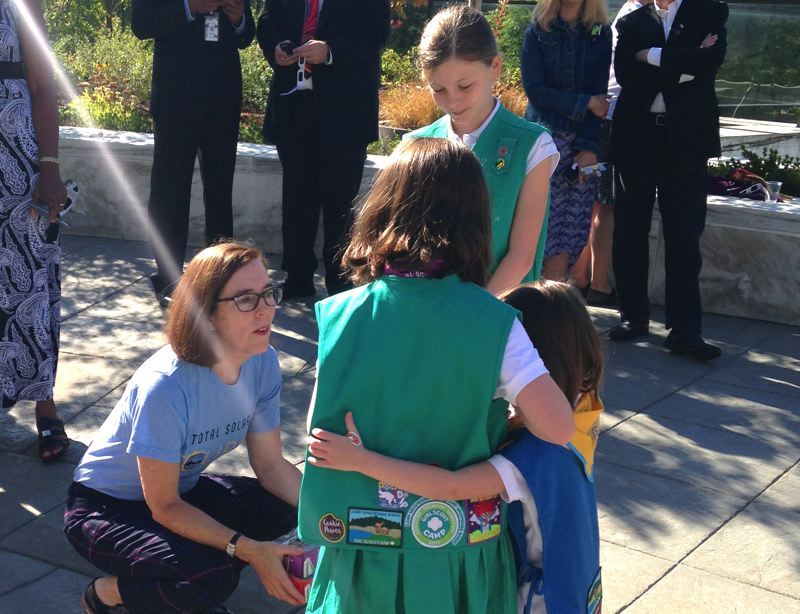 CLAIRE WITHYCOMBE/CAPITAL BUREAU - Oregon Gov. Kate Brown, a former Campfire Girl, chats with Girl Scouts at the Oregon Capitol before the total solar eclipse Monday morning.