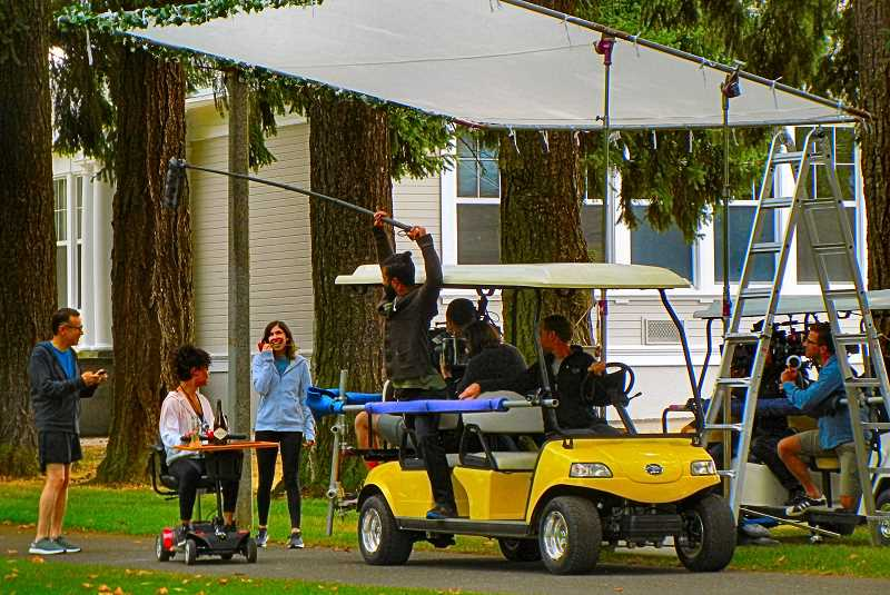 ELIZABETH USSHER GROFF - Filming in Woodstock Park for the eighth and final season of the television comedy Portlandia is Carrie Brownstein - third from left - with some of her crew.