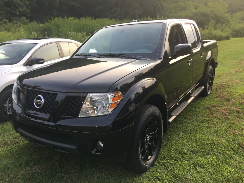 PORTLAND TRIBUNE: JEFF ZURSCHMEIDE - The 2018 Frontier Midnight Edition package includes a gloss black grille, 18-inch gloss black aluminum-alloy wheels, black step rails, black outside rearview mirrors and door handles, black badging, and available Midnight Edition floor mats.