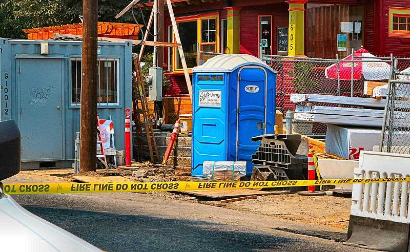 DAVID F. ASHTON - At this Westmoreland construction site, natural gas was escaping from a ruptured mainline - fire and gas company personnel worked to shut off the gas in the street, just west, next to the post office parking lot.
