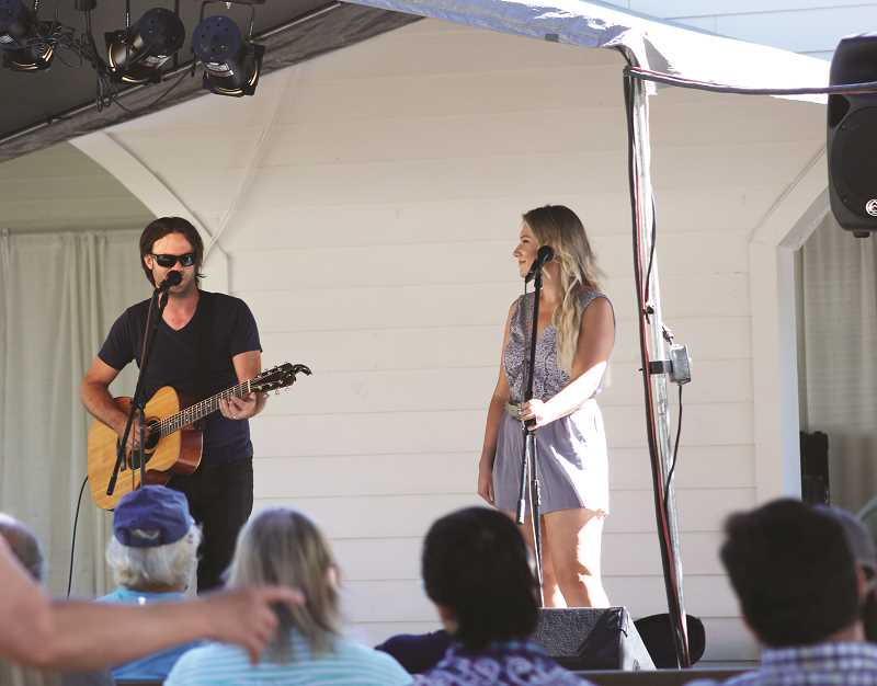 PIONEER PHOTO: KRISTEN WOHLERS - The husband and wife duo Pierce Avenue took the main stage at the Clackamas County Fair on Aug. 17.
