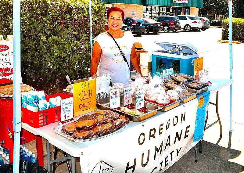 DAVID F. ASHTON - Tinna Barton of Classic Thai Cuisine in Westmoreland sells some of her restaurants delicacies along S.E. Milwaukie Avenue, in support of the Oregon Humane Society.