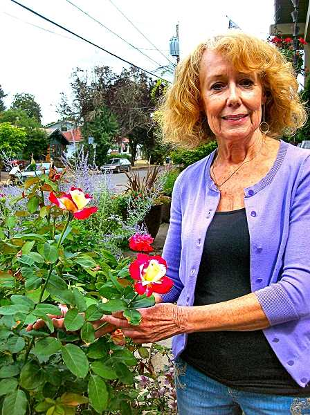 RITA A. LEONARD - Sellwoods Genie Aylor Giles poses with one of her favorite roses, Double Delight.