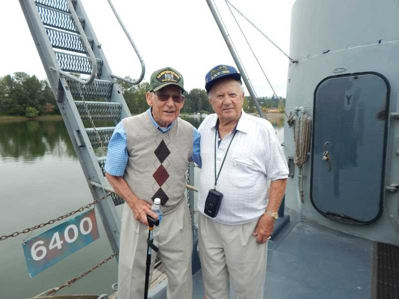 BARBARA SHERMAN - Aboard USS LCI (L)-713 at Swan Island for a tour recently were Navy veterans Carl Finley (left), who served in the Pacific during WWII, and Joe Doyon, who was part of the D-Day invasion on Omaha Beach plus assault crossings of the Rhine River in Germany.