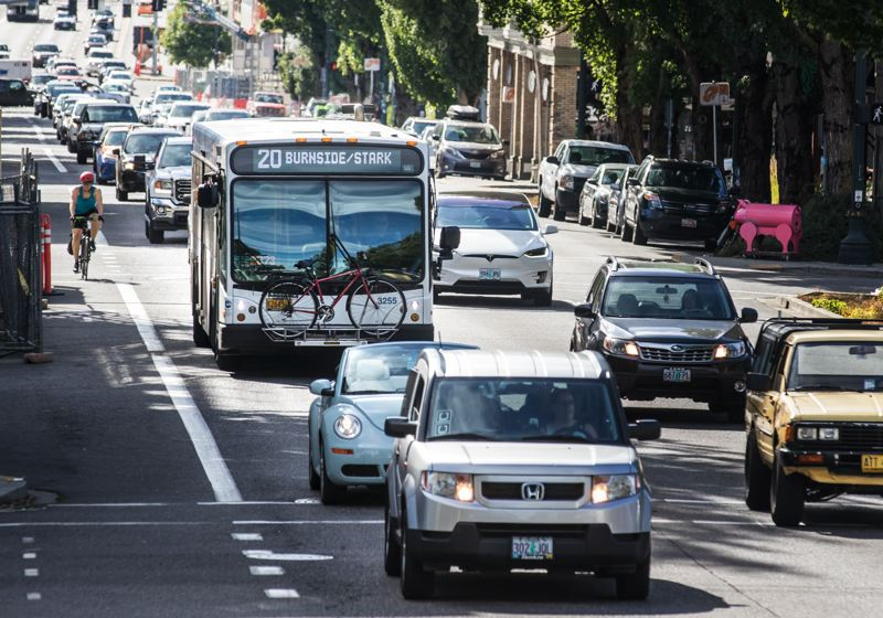 PORTLAND TRIBUNE: JONATHAN HOUSE - TriMet buses can only go so fast up East Burnside — and most other streets — during the afternoon rush hour because of increasing congestion.