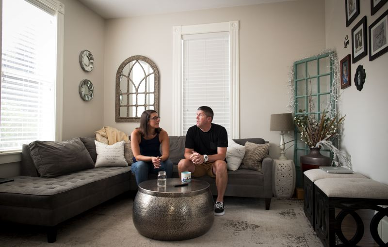 PORTLAND TRIBUNE: JAIME VALDEZ - Michael and Kari Petersen, shown at their Oregon City home. The couple hired a consultant, Steve Anderson, to help negotiate a reduction in their property tax bill.