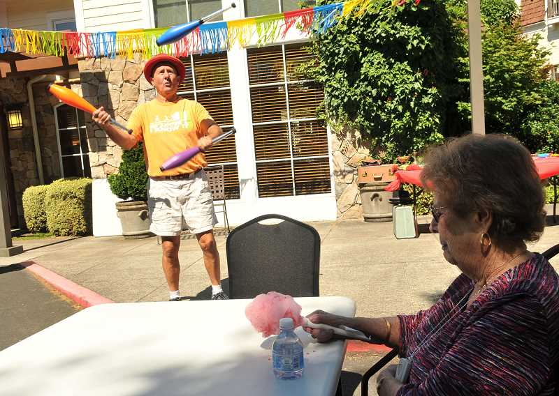 SPOKESMAN PHOTO: VERN UYETAKE - Mag Hughes entertains the seniors with a juggling act Thursday, Aug. 17 at SpringRidge at Charbonneau.