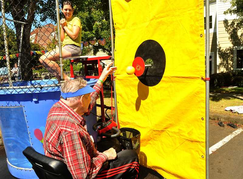 SPOKESMAN PHOTO: VERN UYETAKE - Jim Chase has some fun at the dunk tank.