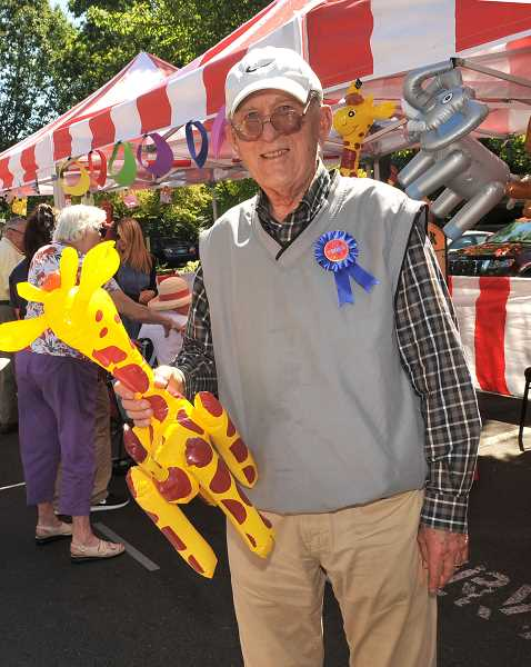 SPOKESMAN PHOTO: VERN UYETAKE - Ed Eastman holds up one of his carnival prizes.