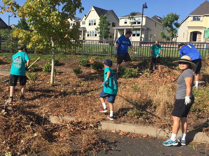 SUBMITTED PHOTOS - The Lowrie Primary community showed up in full force Saturday, Aug. 19 to pull weeds and beautify their school ahead of the first day of school.