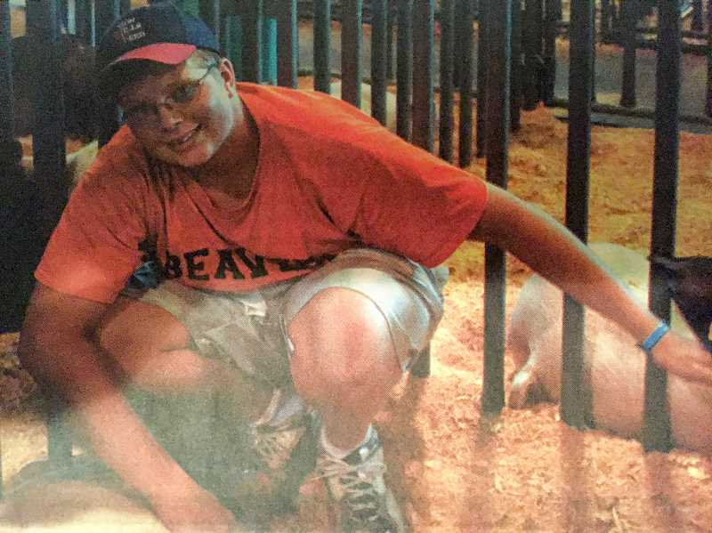 ARCHIVE PHOTO - Sam Peterson, a 16 year old Springwater 4-H member, took his two hogs Black Magic and Mystery to the 2007 Oregon State Fair.