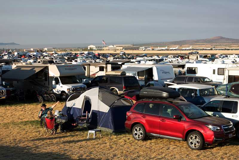 PHOTO BY DAVID BROWNELL - Day campers spread out over the city of Madras' parking area next to the airport. The city's MADclipse Daytripper site was one of more than 20 parking areas and campgrounds in the area, which offered more than 10,000 spots for visitors.