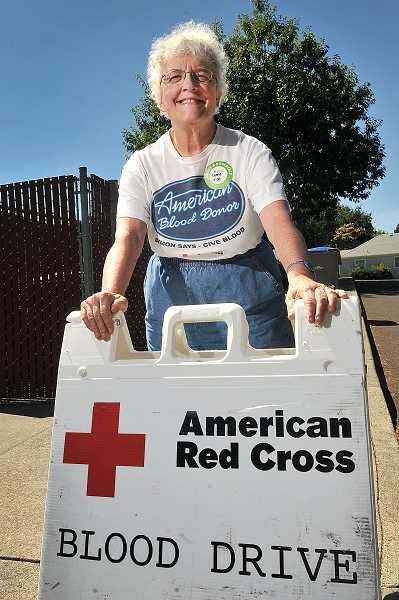 STAFF PHOTOS: VERN UYETAKE - Carrie Brunner of Lake Oswego recently donated the final pint to tally  23 gallons of blood for the American Red Cross.