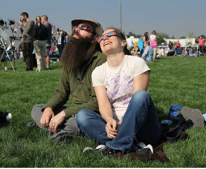 HOLLY M. GILL - Keith Barrette and Kate McPherson traveled all the way from Rhode Island to Central Oregon to be at the Madras High School stadium Aug. 21, for the Lowell Observatory Solar Eclipse Experience.