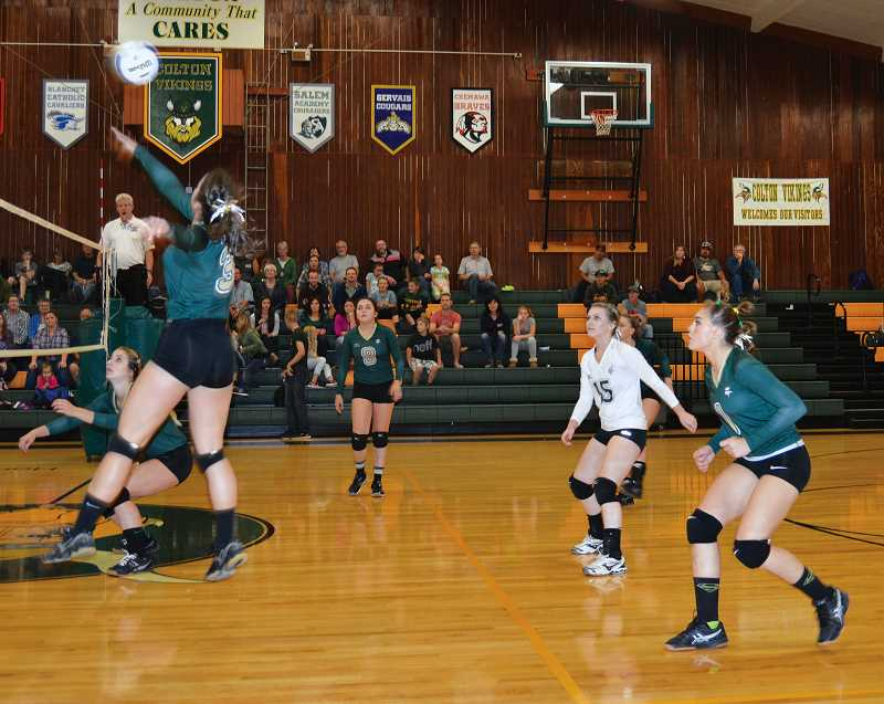 PIONEER FILE PHOTO - Colton senior Brooklyn Olsen (#3, left) is the only returning member of last year's varsity volleyball squad.