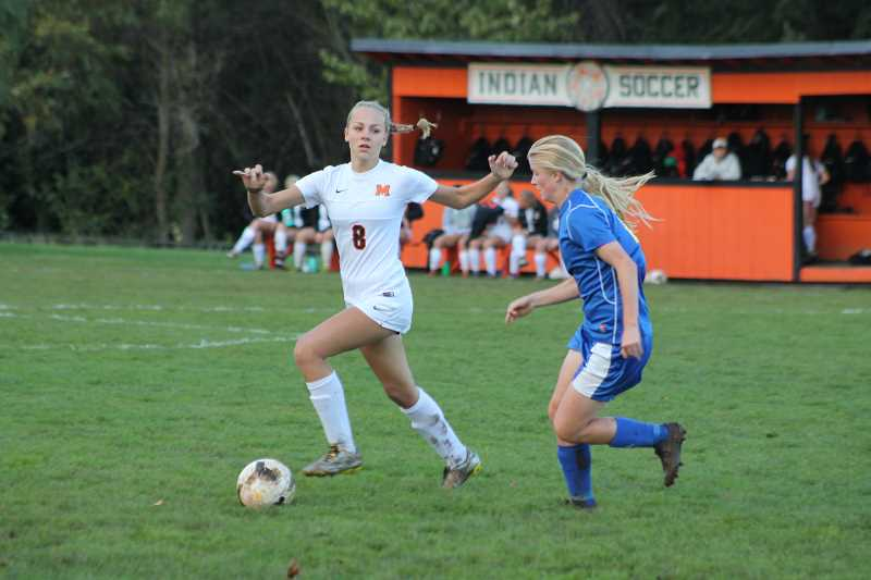 PIONEER PHOTO: CONNER WILLIAMS - Molalla sophomore Maddy Lisac maneuvers past a Crook County defender during a home game last season.