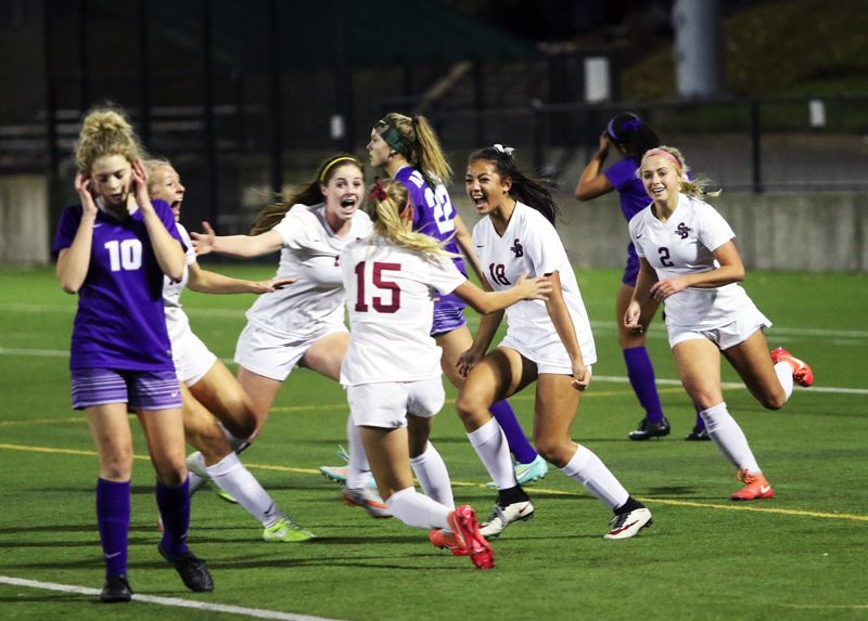 DAN BROOD - Sherwood sophomore Loma McNeese (18) celebrates after scoring a goal in last year's Class 6A state title match. McNeese is the only returning starter for the Lady Bowmen.