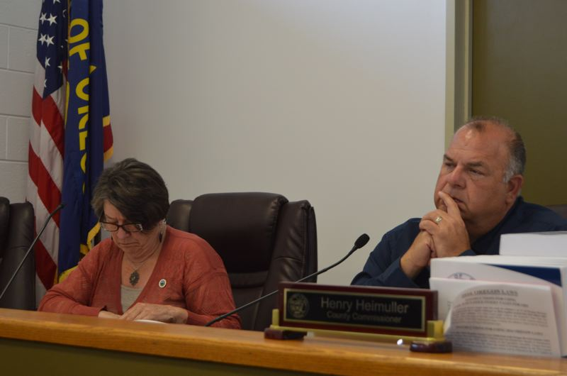 SPOTLIGHT PHOTO: COURTNEY VAUGHN - Columbia County Commissioners Margaret Magruder and Henry Heimuller review testimony and evidence during a public hearing Wednesday, Aug. 23. Commissioners heard an appeal over a Rainier mobile home park's proposed wastewater system upgrades.