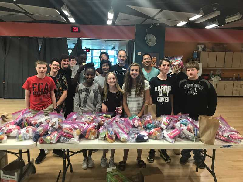 COURTESY SHERWOOD YMCA - YMCA Teen Center Ambassadors helped create 90 hygiene kits for homeless people.