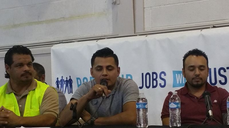 SOURCE: PORTLAND JOBS WITH JUSTICE - Latino carpenters share personal stories at a Workers Rights board hearing.