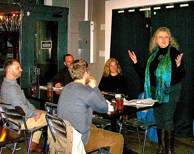 """RITA A. LEONARD - Jean Richardson welcomes poets to a meeting of the monthly """"Shut Up & Eat Open Mic Poetry"""" group on S.E. Gladstone Street."""