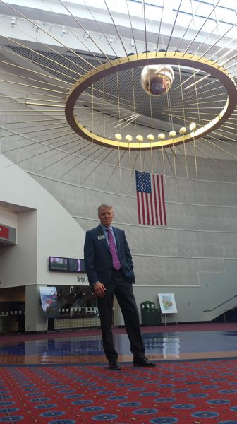 PAMPLIN MEDIA GROUP: JOSEPH GALLIVAN  - The new Executive Director of the Oregon Convention Center, Craig Stroud, stands under Principia, the Foucault pendulum installed in 1990. The 900 pound bronze ball swings around, proving that the earth rotates.