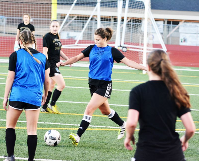 SPOTLIGHT PHOTO: JAKE MCNEAL - Lions senior defender Emelia Reardon squares up a kick.