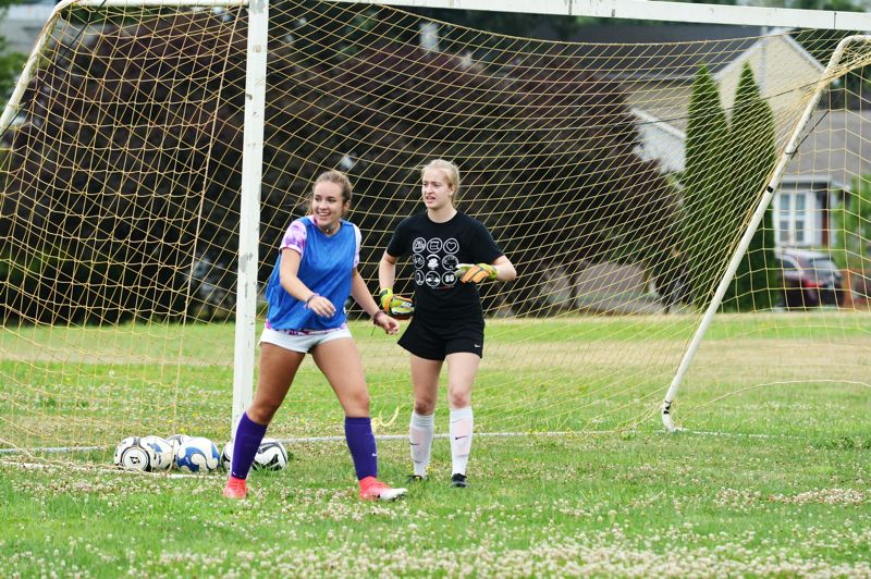 SPOTLIGHT PHOTO: JAKE MCNEAL - Senior goalkeeper Alyssa Bakkensen, right, senior forward Natalee Irwin and the Indians are ready to begin a seventh deep Class 4A state run in eight years.