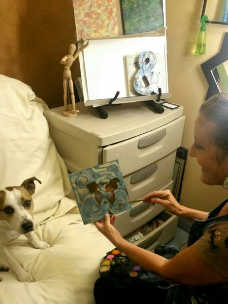 SUBMITTED PHOTO - Local artist Denise Emmerling-Baker works on a Little By Little piece with her favorite model.