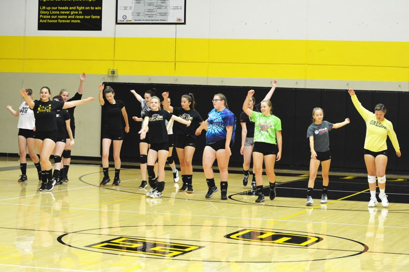 SPOTLIGHT PHOTO: JAKE MCNEAL - Senior libero Abby Austin, pictured far right at tryouts, is one of five new fourth-year players on the Lions' varsity squad.