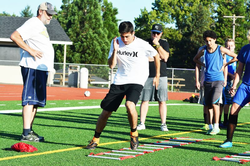 SPOTLIGHT PHOTO: JAKE MCNEAL - Lions senior defender Daniel Lujano clears an agility drill in practice at Doc Ackerson Stadium in St. Helens.