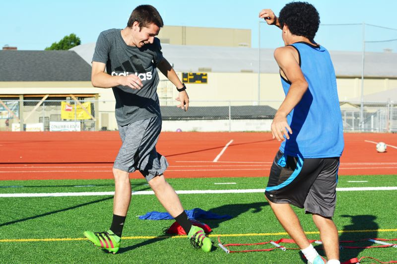 SPOTLIGHT PHOTO: JAKE MCNEAL - Lions senior forward Pacey Littleton clears an agility drill in practice at Doc Ackerson Stadium in St. Helens.