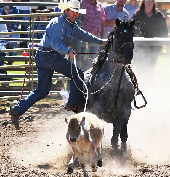LON AUSTIN/CENTRAL OREGONIAN - J.W. Rose competes in tie-down roping at last year';s Paulina Rodeo.