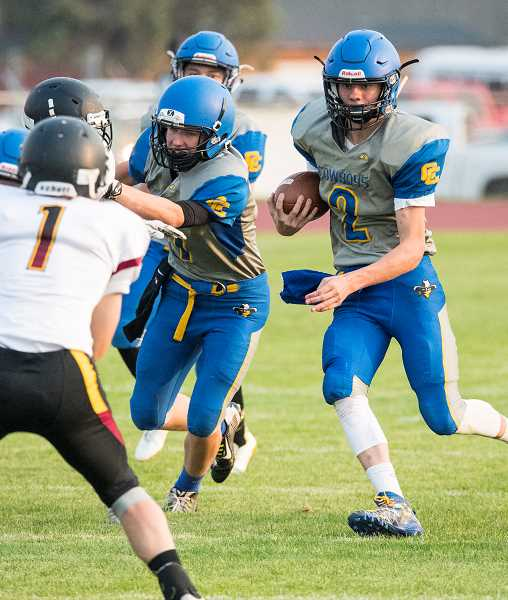 LON AUSTIN/CENTRAL OREGONIAN - Colton Burkhardt carries the ball for a short gain against The Dalles during the Redmond Jamboree last Friday. Crook County and The Dalles played to a scoreless tie.