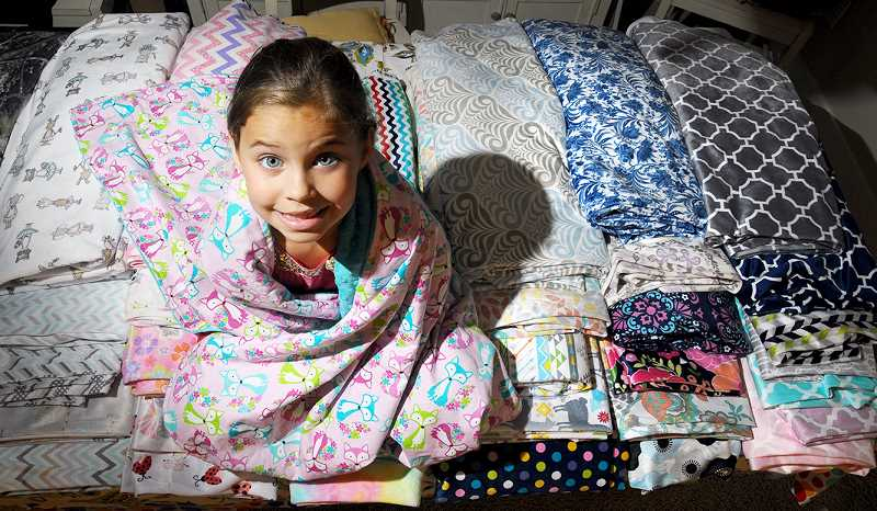 GARY ALLEN - After spending 29 days at Doernbecher Children's Hospital following an E. Coli infection in 2016, 7-year-old Maddi Fallon and her family have started Maddi's Lovelies to provide blankets to the other young patients at the hospital.